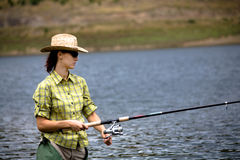 Young woman fishing Royalty Free Stock Photography