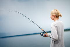 Young Woman Fishing Mackerel in Vacation Stock Photos
