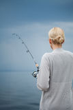 Young Woman Fishing Mackerel in Vacation Royalty Free Stock Photography
