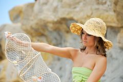 Young woman with fishing net. Beautiful young woman with fishing net stock images
