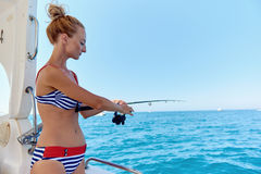 Young woman with a fishing rod fishing Royalty Free Stock Image