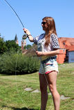 Young woman with fishing rod on a river in Germany Stock Photos