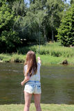 Young woman with fishing rod on a river in Germany Royalty Free Stock Image