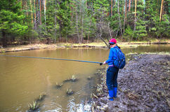 Young woman fishing on a small river Royalty Free Stock Photography