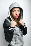 Young woman with fists in attack position ready to fight Royalty Free Stock Photo