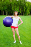 Young woman with fitball Stock Photos