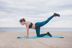 Young woman fitness on the beach. stock photography
