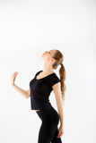 Young woman fitness. In the black sports clothes on white backgr Royalty Free Stock Image