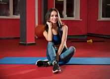 Young woman in fitness club stock photo