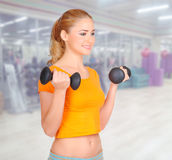 Young woman at fitness club Royalty Free Stock Images