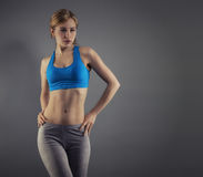 Young woman in fitness dress Royalty Free Stock Photo