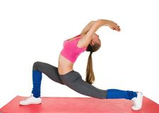 Young woman fitness exercises Stock Images
