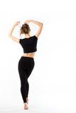 Young woman fitness. Full length from the back in black sportswe Royalty Free Stock Images