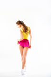 Young woman fitness. Full length from back in sportswear on a white background stock image