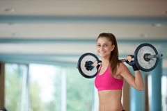 Young woman in fitness gym lifting  weights Royalty Free Stock Photos