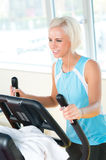 Young woman on fitness machine cardio exercise Royalty Free Stock Image