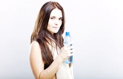 Young woman after fitness with towel and water bottle Royalty Free Stock Image
