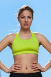 Young woman in fitness wear outdoors Royalty Free Stock Photography
