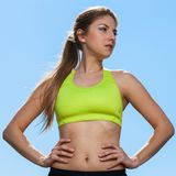 Young woman in fitness wear outdoors Stock Photos