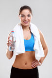 Young woman in fitness wear with towel Stock Photography