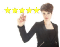 Young woman with five stars isolated Stock Images