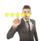 Young woman with five stars isolated Stock Photos