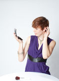 Young woman fixing her hair Royalty Free Stock Images
