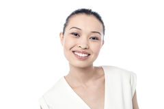 Young woman flashing a smile Royalty Free Stock Photo
