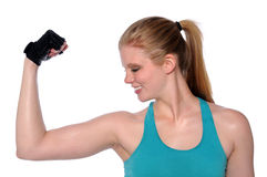 Young Woman Flexing Arm Royalty Free Stock Photo