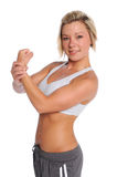 Young Woman Flexing Arm Royalty Free Stock Image