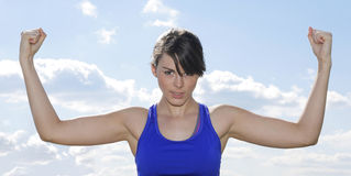 Young woman flexing her muscles Royalty Free Stock Photo