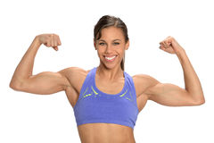 Young Woman Flexing Muscles. Young African American woman flexing muscles isolated over white background Stock Image