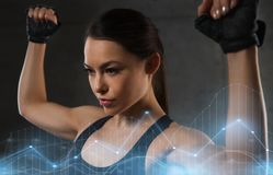 Young woman flexing muscles in gym. Sport, fitness, bodybuilding, weightlifting and people concept - young woman flexing muscles in gym Stock Images