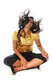 Young Woman Flipping Hair. Sitting on a white background Stock Images