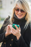 Young woman flirting by messages. A small series of photos. Elena Stock Image