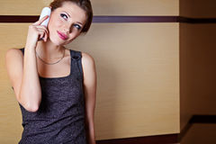 A young woman flirting  on the phone Stock Photos