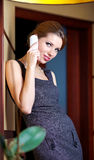 A young woman flirting  on the phone Stock Image