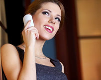 A young woman flirting  on the phone Stock Images