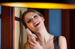 A young woman flirting  on the phone Stock Photography