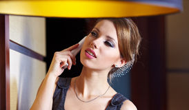 A young woman flirting on the phone Royalty Free Stock Images