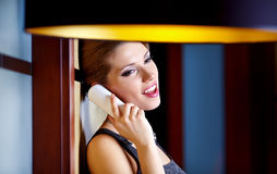 A young woman flirting  on the phone Royalty Free Stock Photo