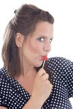 Young woman flirting using lollipop Royalty Free Stock Images