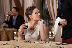 Young woman flirting with waiter Stock Image