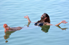 Young Woman floating on the Dead Sea, Israel Stock Photo