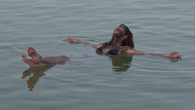 Young Woman floating on the Dead Sea, Israel stock footage