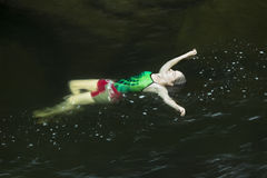 Young woman floating, suspended, Sugar River, Newport, New Hamps Royalty Free Stock Photos