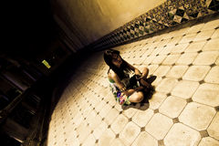 Young woman on the floor. Young woman sited on the sanitarium floor royalty free stock photography