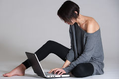 Young woman on floor with notebook Royalty Free Stock Photography