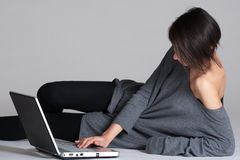 Young woman on floor with notebook Royalty Free Stock Image