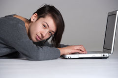 Young woman on floor with notebook Royalty Free Stock Images